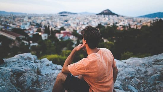 PM-guy-pondering-city-below-1